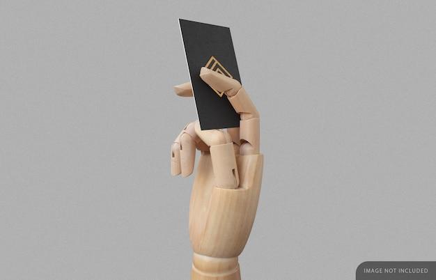 木製の手のモックアップの名刺