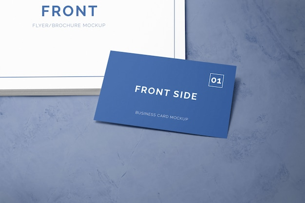 Business card laying on a stack of paper