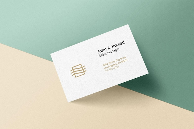 Business card laying on a wall mockup