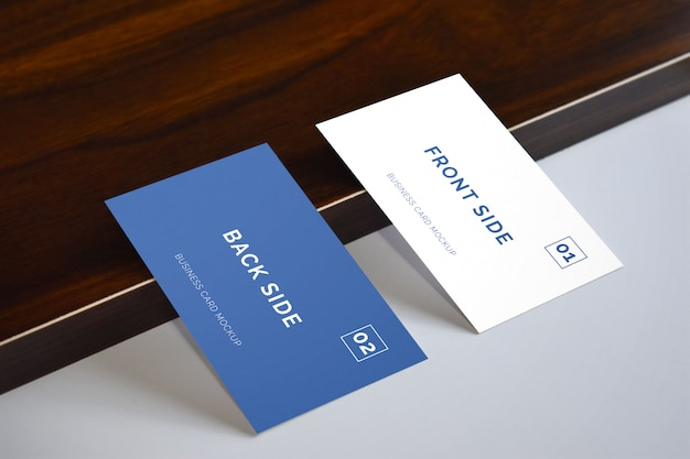 Business card laying on wood mockup