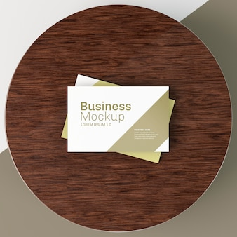 Business card mock-up on circular wooden board
