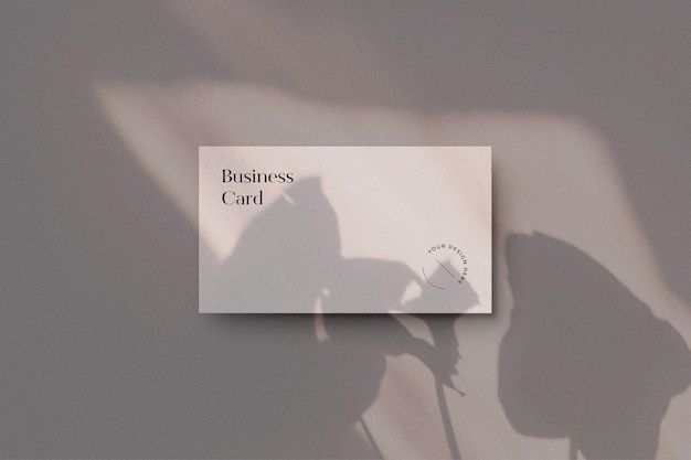 Business card mockup on beige and shadow overlay