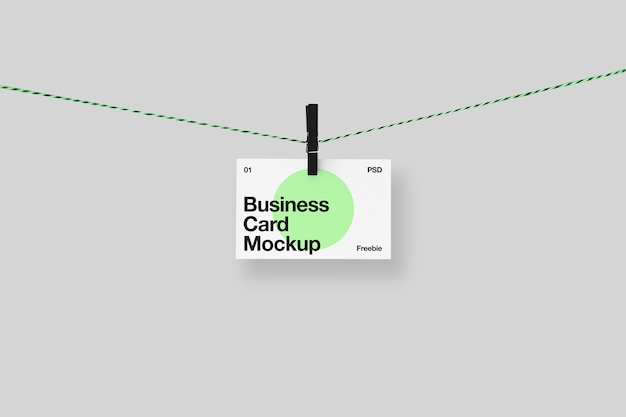 Business card mockup on clothesline