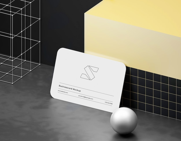 Business card mockup on dark background with glossy sphere and tiles