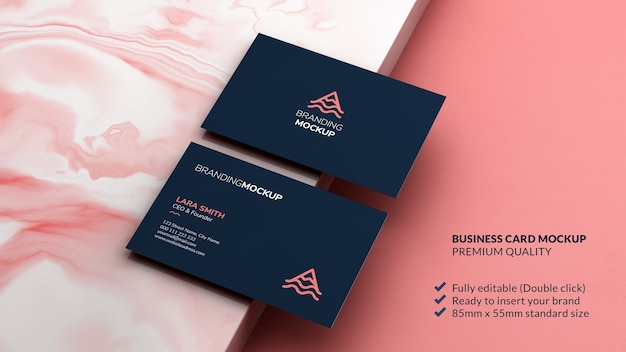Business card mockup on a marble surface as branding design concept