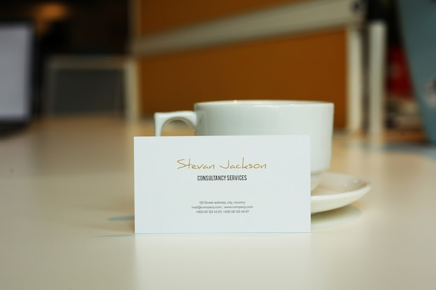 Business card mockup psd with coffee or cappuccino or tea cup