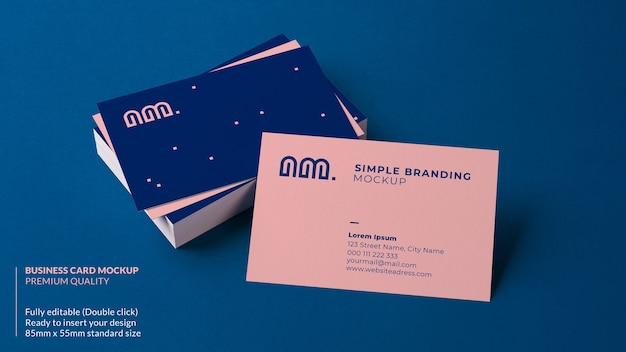 Business card mockup resting on a stack of cards