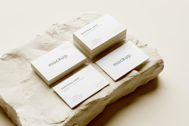 Business card mockup and stack perspective view with white rock