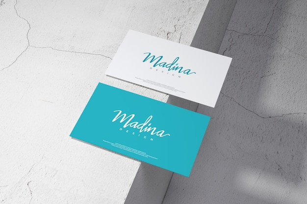 Business card mockup on wall background
