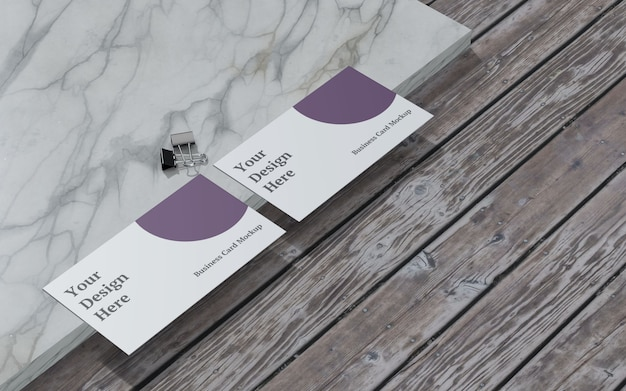 Business card mockup with binder clip left view