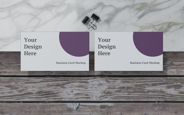 Business card mockup with binder clip top view