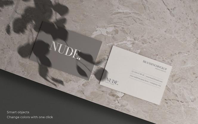 Макет визитной карточки с ботанической тенью и мраморной текстурой