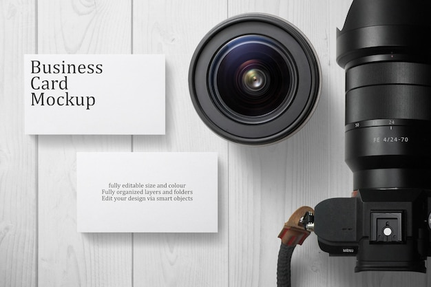 Business card mockup with camera decoration