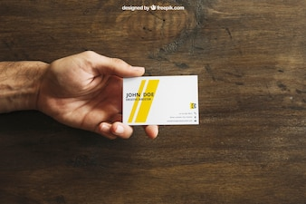 Business card mockup with hand