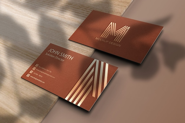 Business card mockup with leaves shadow overlay