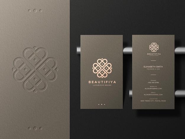 Business card mockup with letterpress logo on background