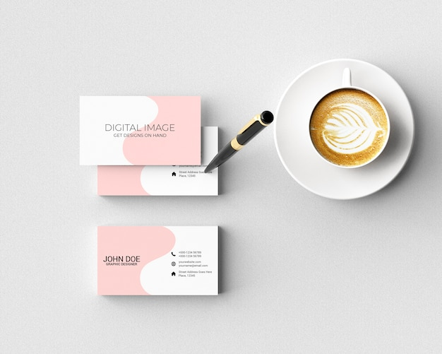 Business card mockup with pen and coffee