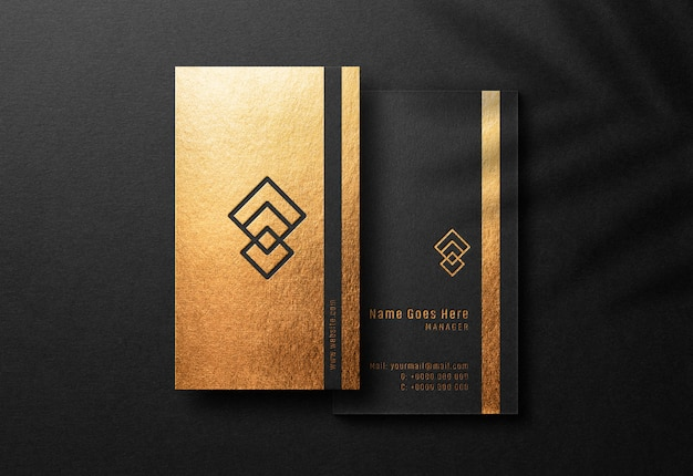 Business card mockup with pressed gold print effect
