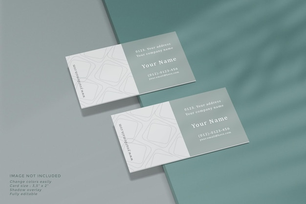 Business card mockup with shadow overlay on surface