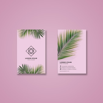Business card mockup with tropical leaves