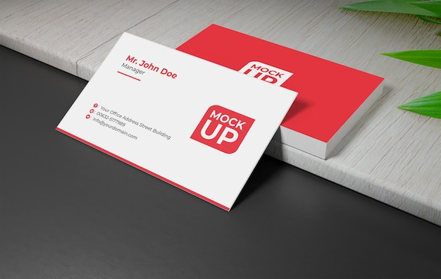 Business card mockup on the wood with leaf