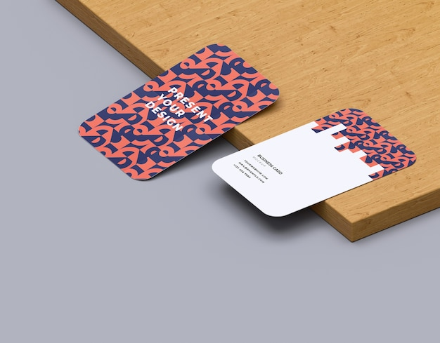 Business card mockup on wooden board