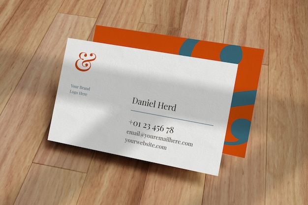 Business card mockup in wooden floor