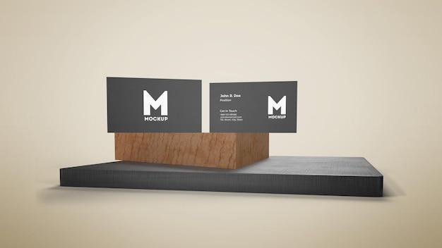 Визитная карточка на деревянном подиуме макет