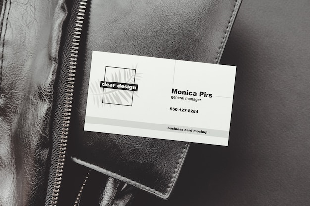 Business card on portmone black scene mockup