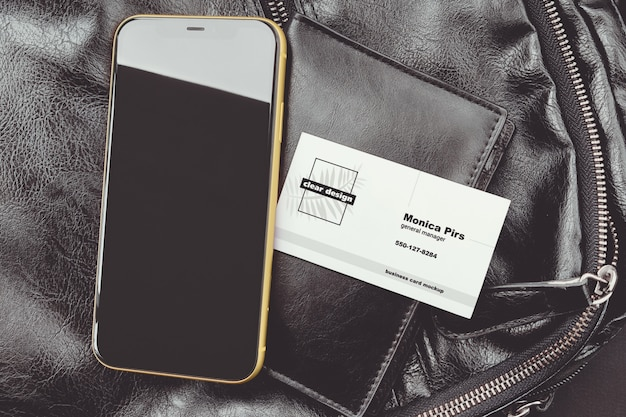 Business card on portmone with a phone scene mockup