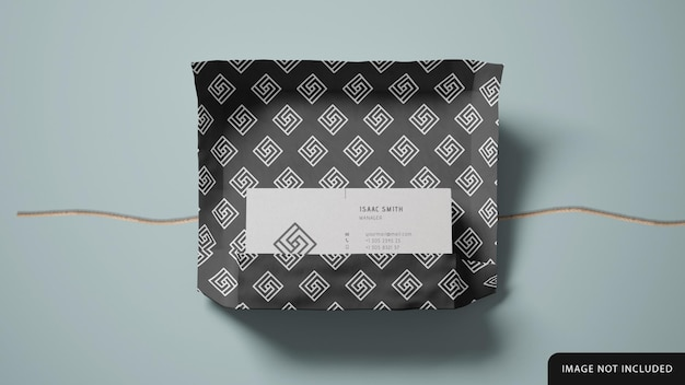 Business card stack mockup with wrapping paper