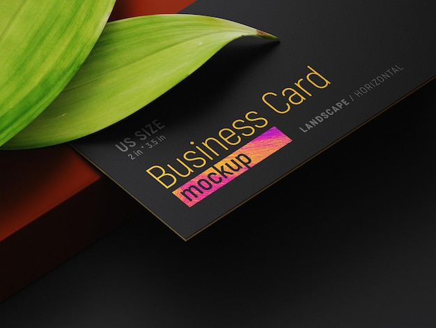 Business card on two leaves and a pencil mockup perspective view