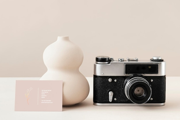 Business card with an analog camera