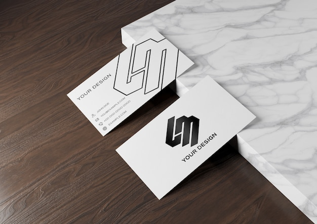 Business card on wood and marble surface mockup