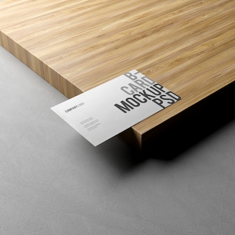 Business card on wood texture mockup