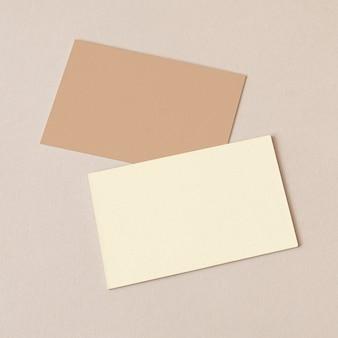 Business cards on beige background mockup