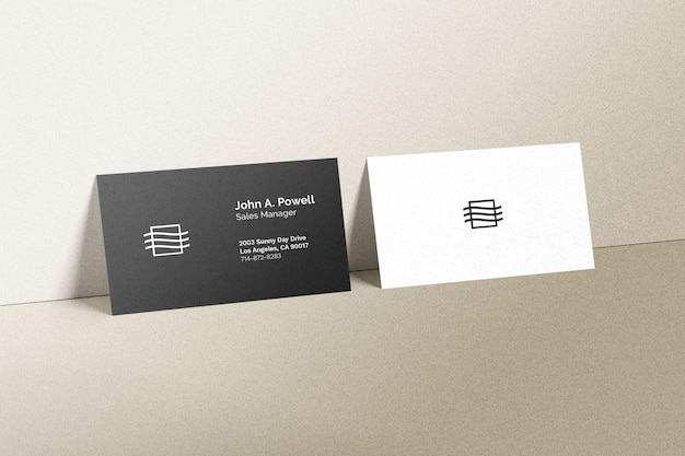 Business cards laying on a wall mockup