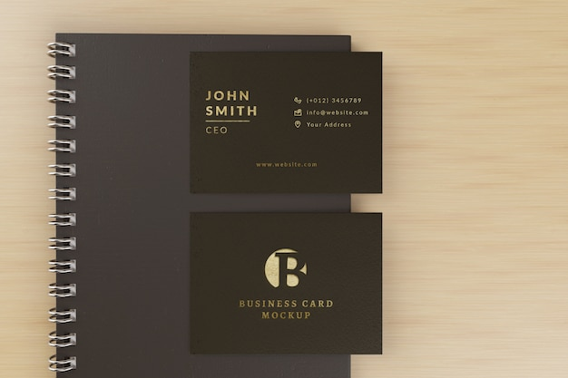 Business cards mockup with notebook