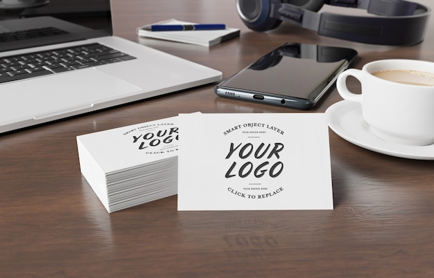 Business cards mockup on wooden desk with desktop elements 3d rendering