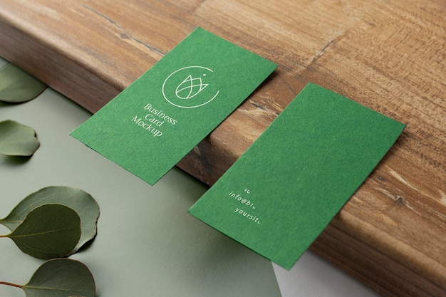 Business cards on wooden board high angle