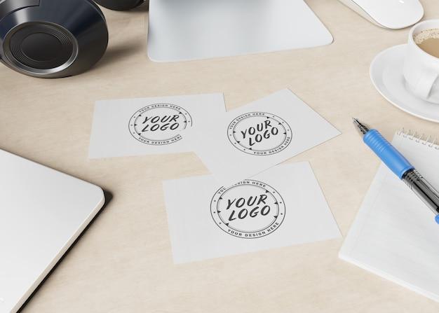 Business cards on wooden desk mockup