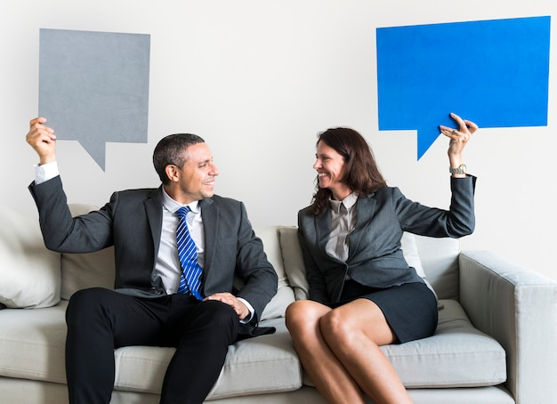Business couple with speech bubbles
