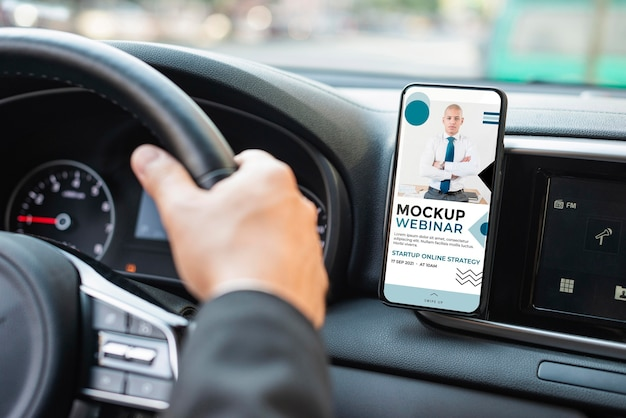 Business man in car with phone mockup