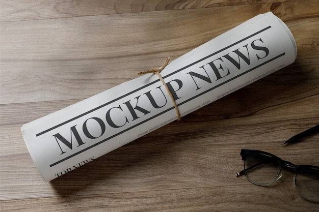 Business newspaper mockup template with glasses