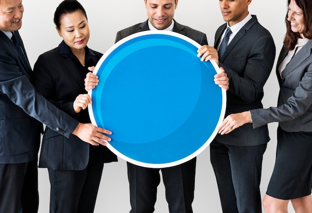 Business people standing and holding icon