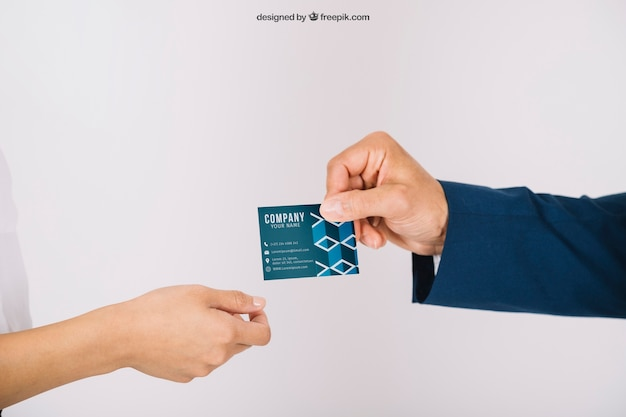 Business persons exchanging business card