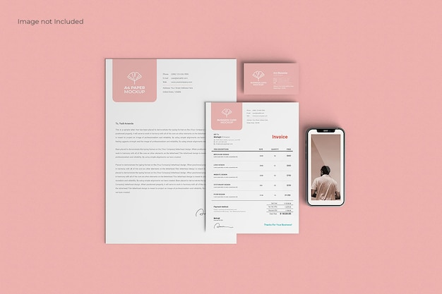 Business stationery mockup on pink surface, top view