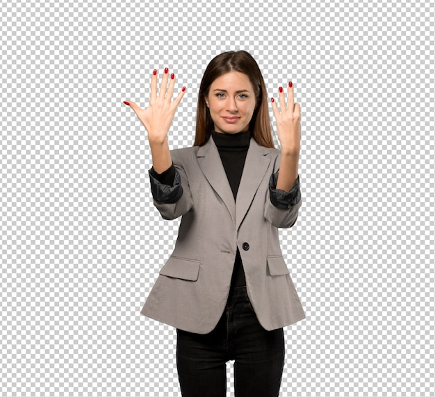 Business woman counting eight with fingers