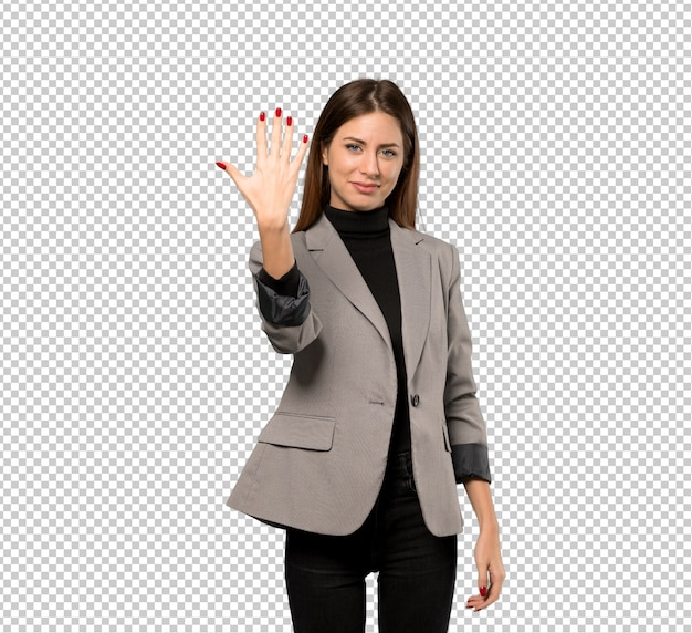 Business woman counting five with fingers