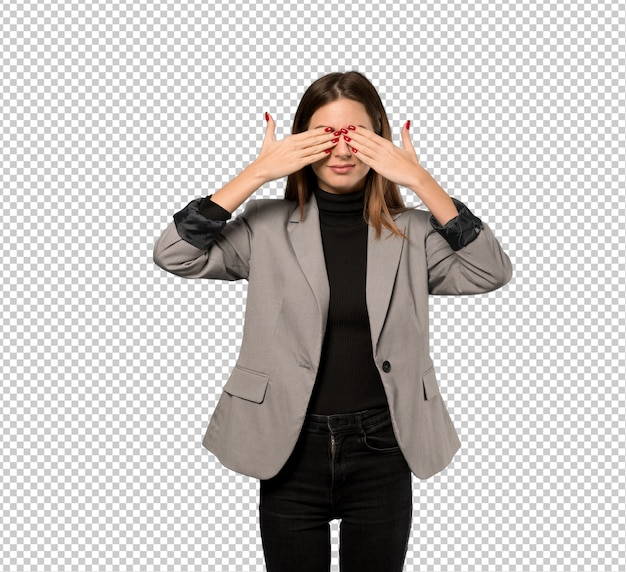 Business woman covering eyes by hands. surprised to see what is ahead